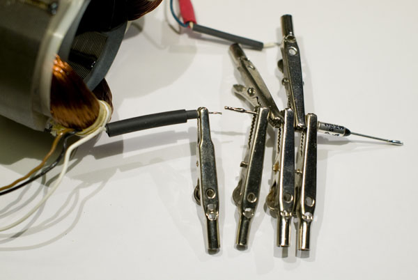 More alligator clips used to divert heat from the solder joint.