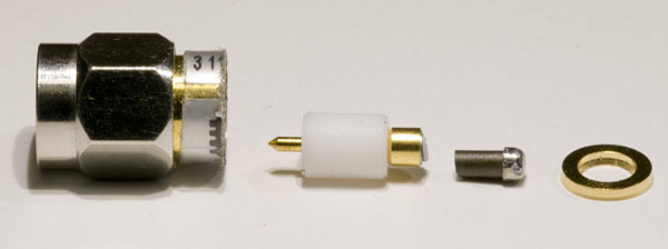 Side view of pieces of the disassembled termination.