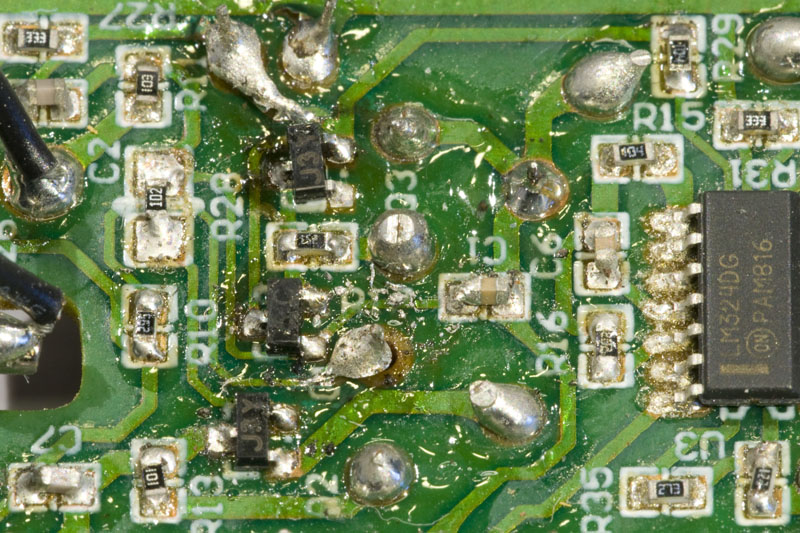 Close-up of badly soldered PCB.