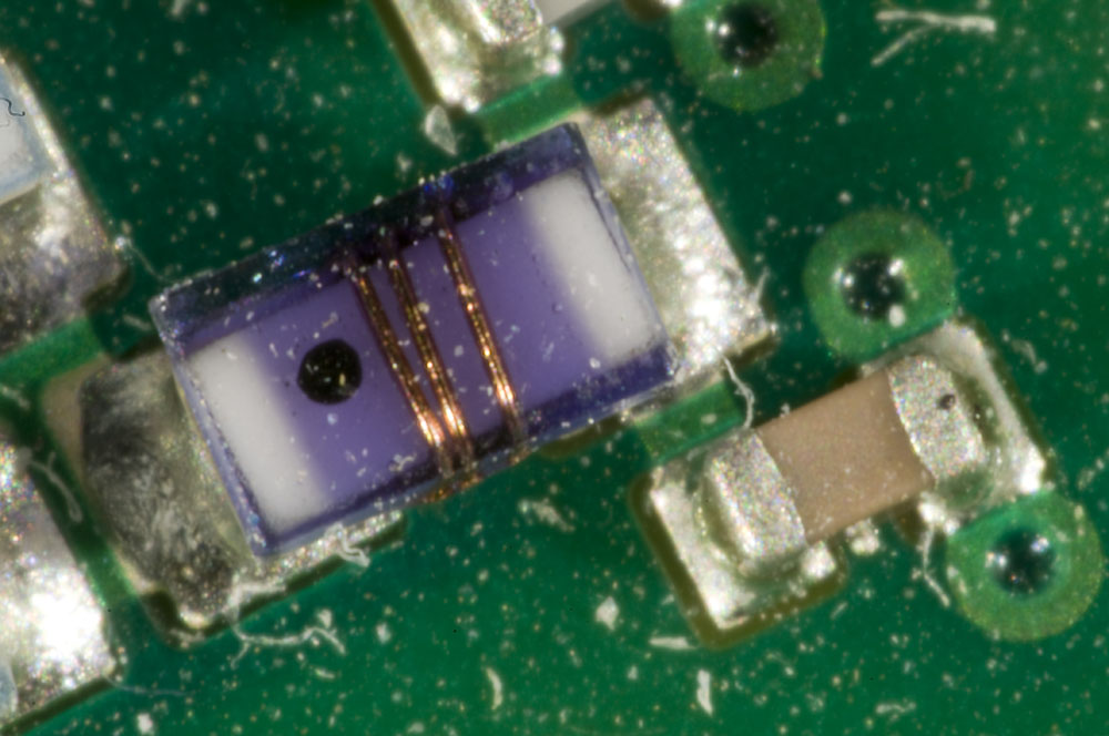 An 0603 inductor and an 0402 capacitor.