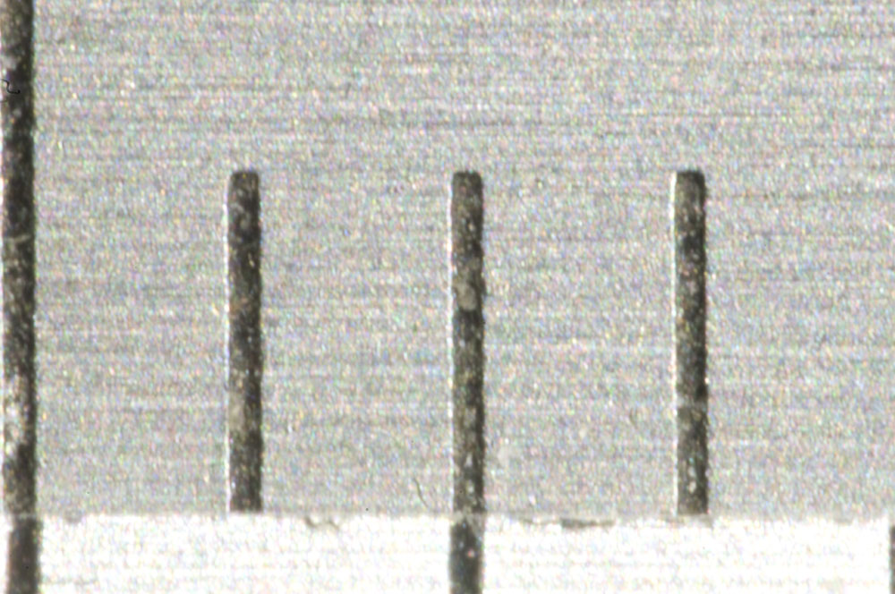 Millimeter lines on the scale of a caliper. The field of view is about 4 mm wide.